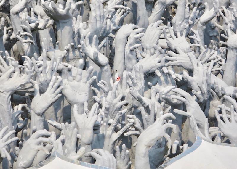 Wat Rong Khun White Temple In Chiang Rai – hundreds of hands from hell
