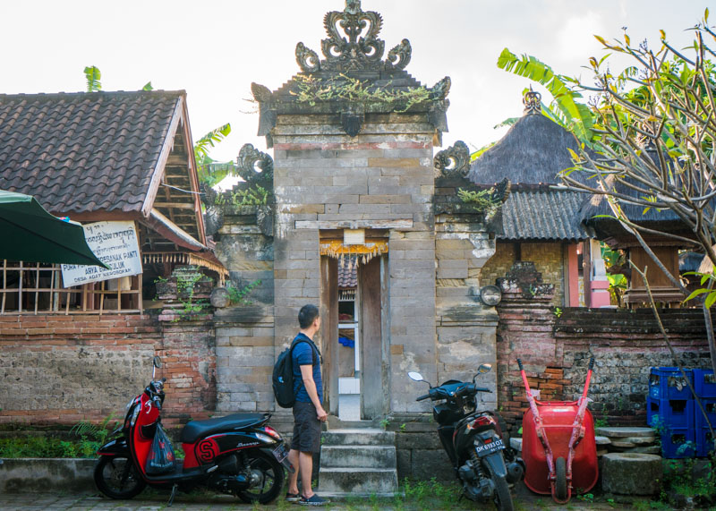 living as a nomad - bali motorcycles temple asian man