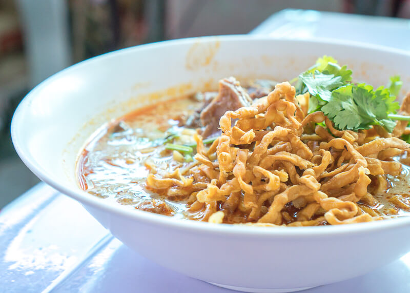 the best khao soi in our travels in thailand as modern nomads