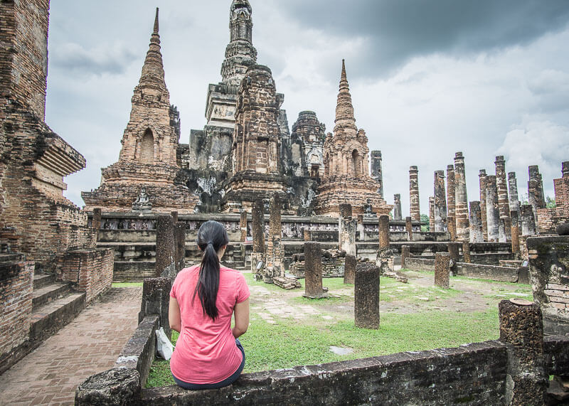 sitting down to admire temples in sukhothai thailand