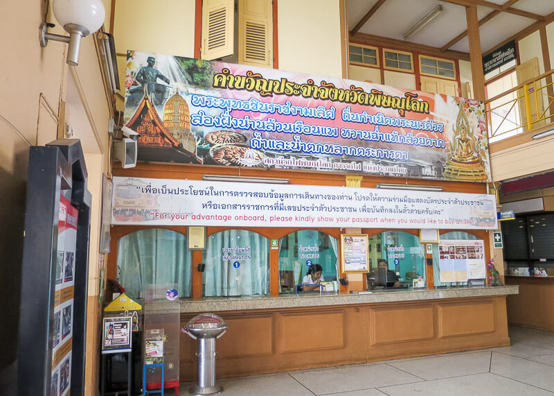 ticket counter at phitsanulok train station before boarding train to chiang mai