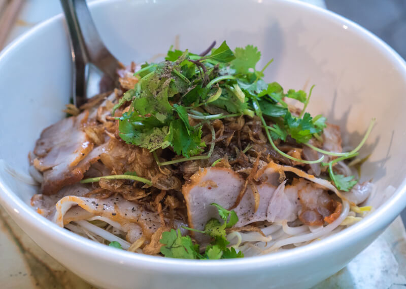 Best Food Hanoi Vietnam - Dried hủ tiếu with pork, fresh herbs, and dried garlic