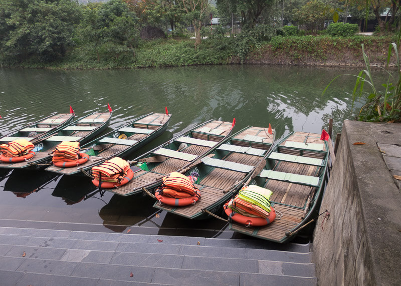 Trang An Grottoes tour - boats docked
