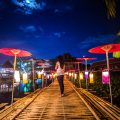semi-nomadic life in chiang mai - asian girl on bamboo path lanterns full moon