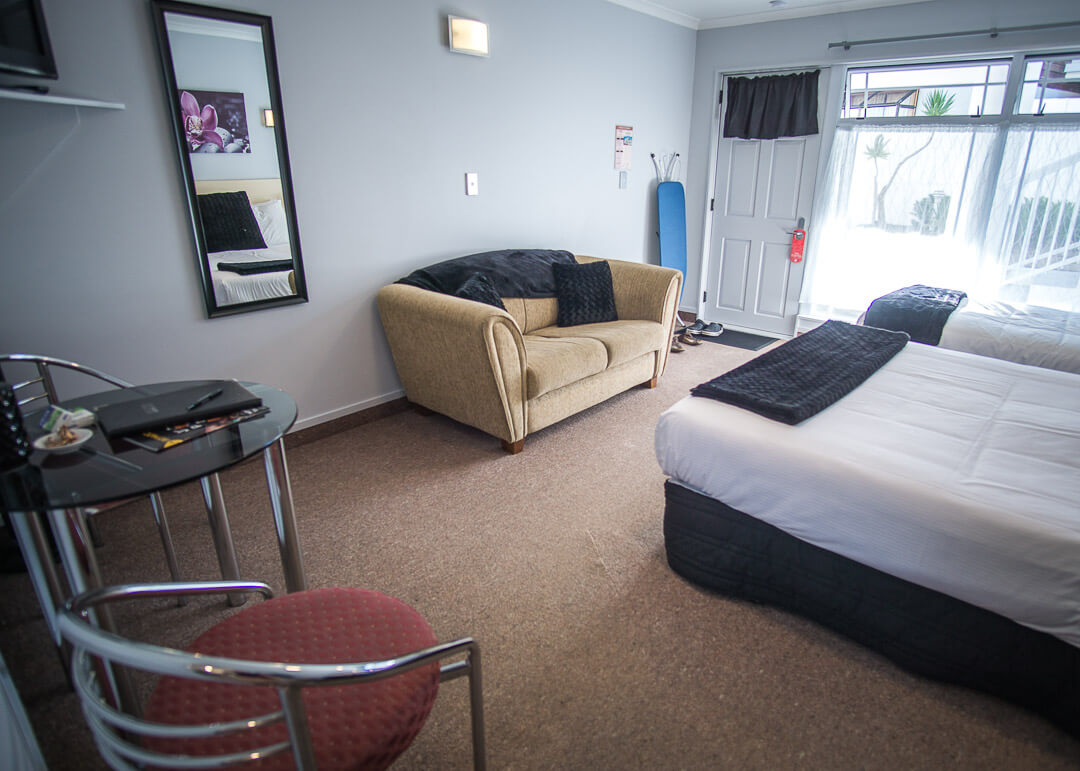 Executive Motel Taupo New Zealand - couch and table