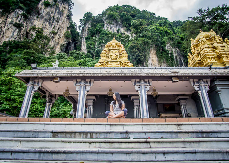 Climbing Batu Caves Steps to See the Famous Temple Cave | Kuala Lumpur has been on my bucket list for over a decade. The street food is incredible, along with the twin towers and the Batu caves. Click to read more and see the photography about the Batu Caves #nomad #batucaves #wanderlust #malaysia #slowtravel