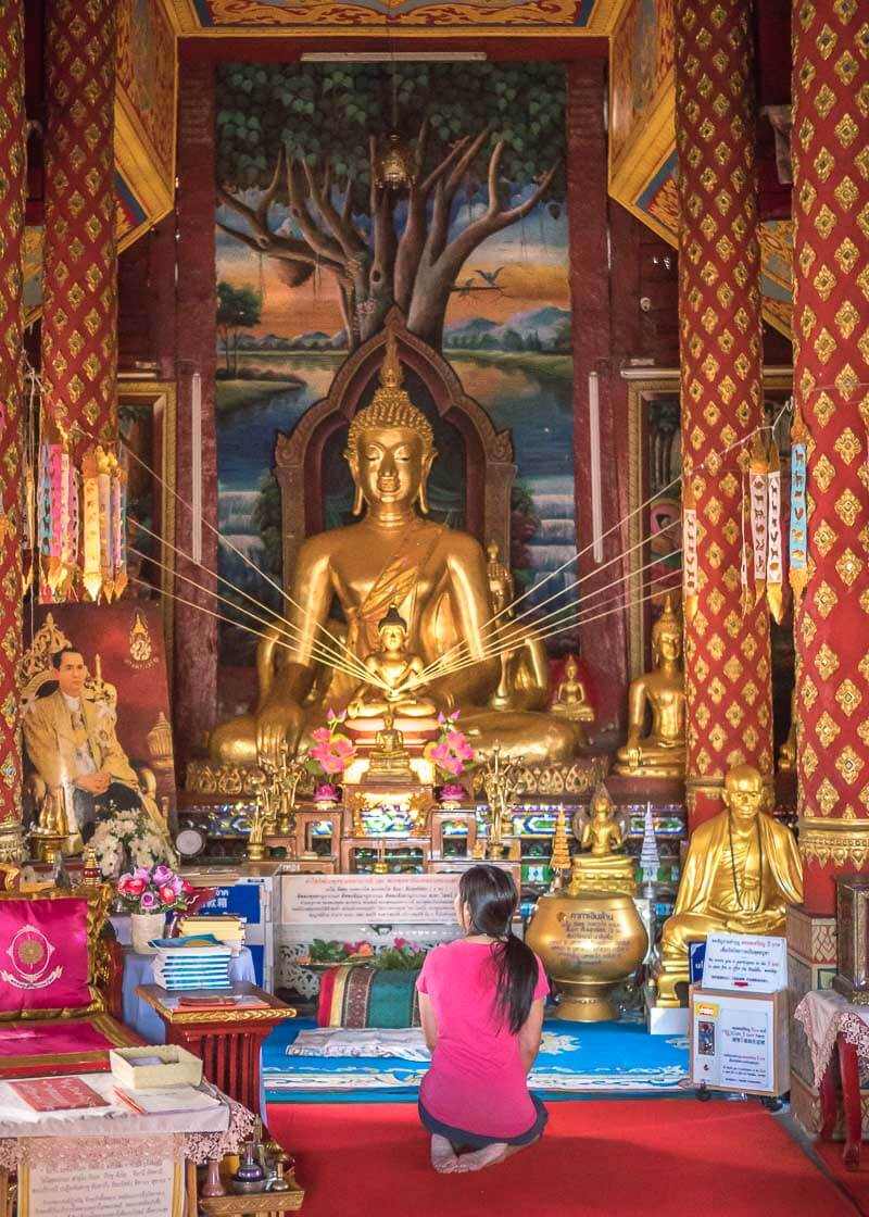 living in chiang mai thailand - temple with buddha