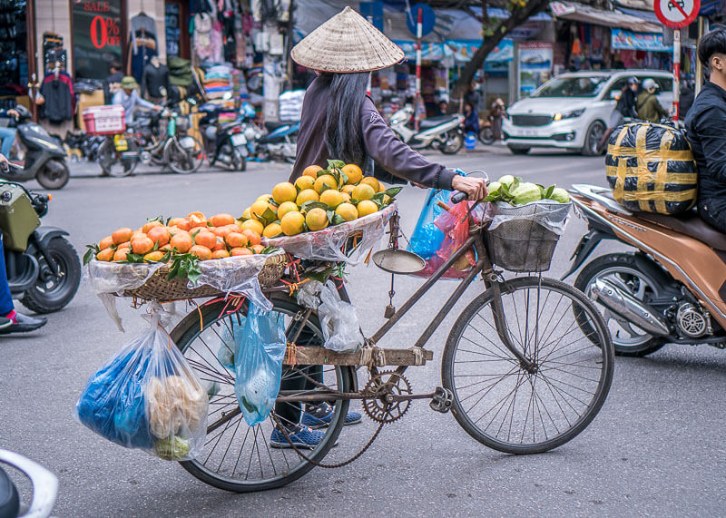 Hanoi travel blog - fruit lady crossing