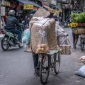 Hanoi travel blog - street vendors pushing bike
